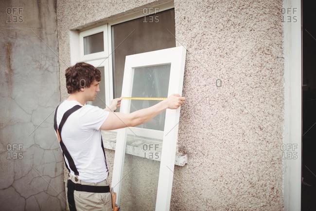 Carpenter measuring a door