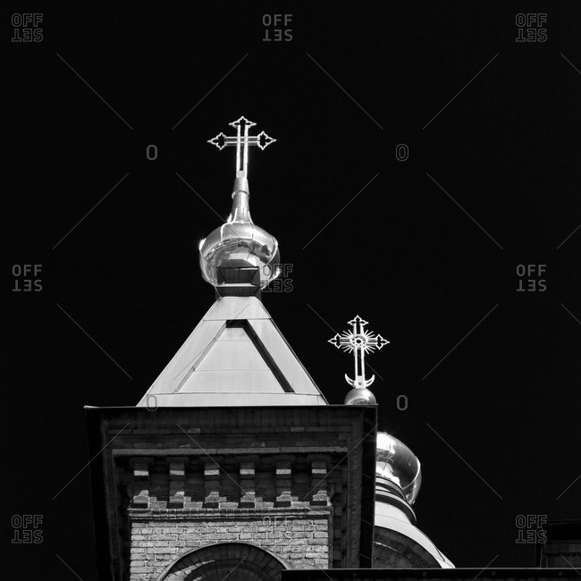 Ornate crosses on church towers