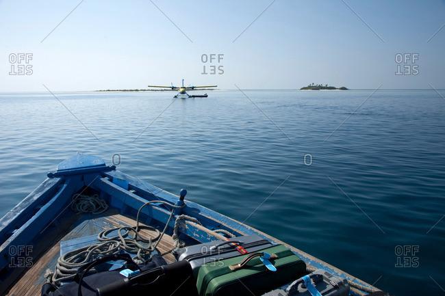 Water plane flying towards boat