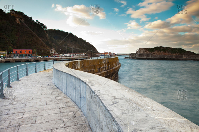Ornate stone walkway on urban harbor