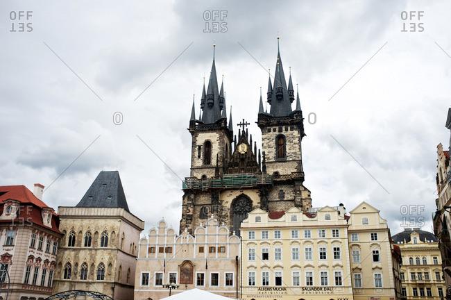 Prague, Czech Republic - April 12, 2013: Ornate church overlooking city buildings