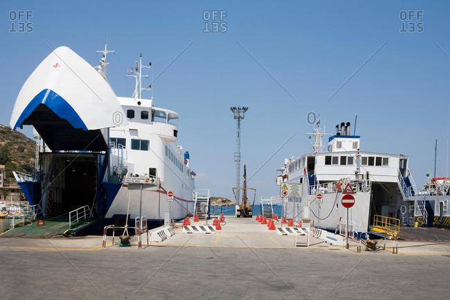 Ships docked in rural harbor