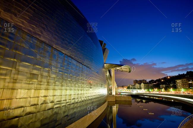 Bilbao, Spain - April 25, 2013: Ornate building on urban canal