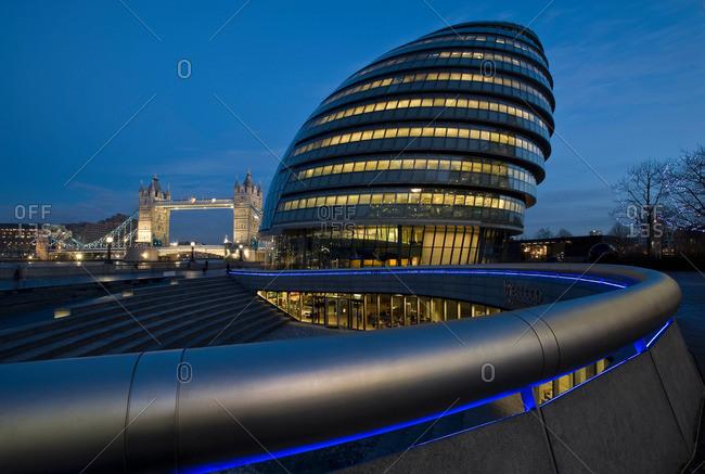 London, UK - April 25, 2013: Ornate urban building lit up at night