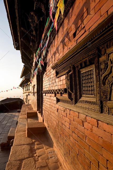 Ornate carvings on brick building