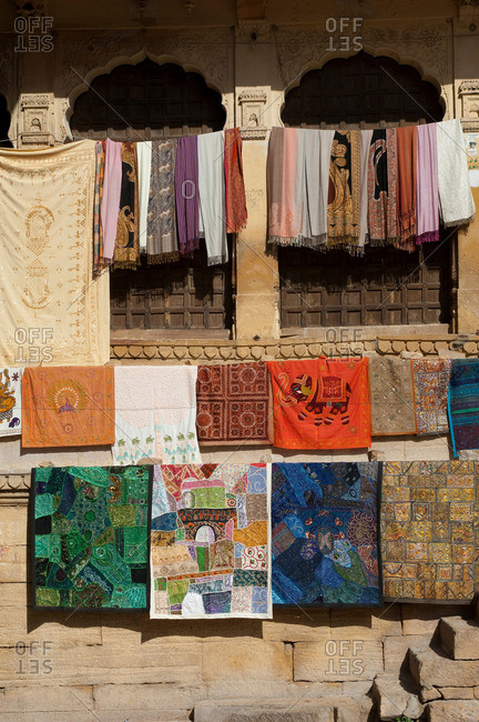 Fabrics and textiles for sale at Jaisalmer Fort, the 'Golden Fort' It is one of the largest forts in the world Jaisalmer, Rajasthan, India
