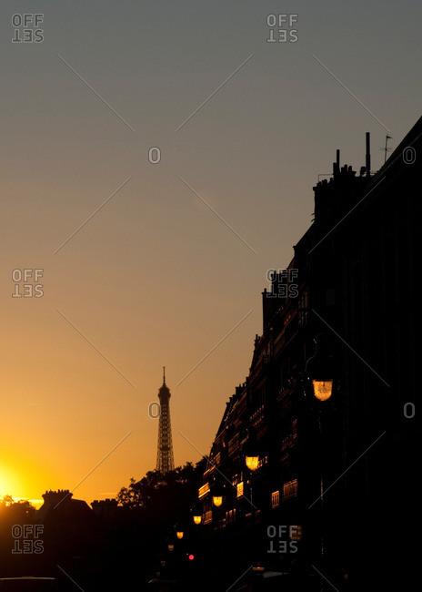 A Parisian street and the Eiffel Tower at dawn