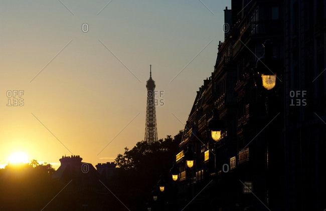 A Parisian street and the Eiffel Tower in the morning