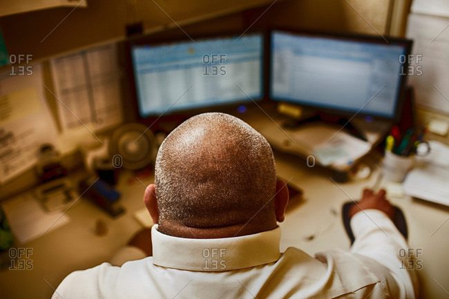 Mature man working in control room of manufacturing plant
