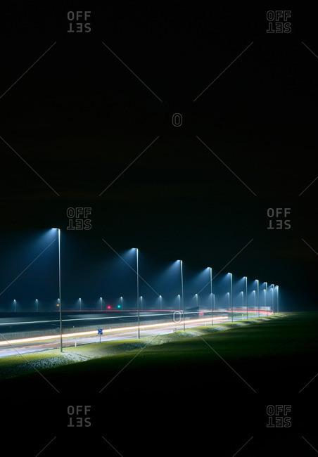 Night shot of new road built on land reclaimed from sea, Rotterdam harbor, Massvlakte, Rotterdam, Netherlands
