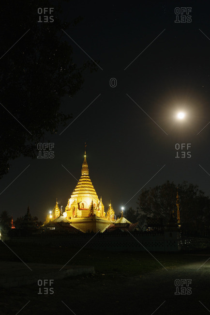 Temple and full moon at night, Nyaung Shwe, Inle Lake, Burma