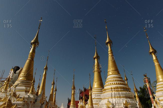 Temple spires at dusk, Nyaung Shwe, Inle Lake, Burma