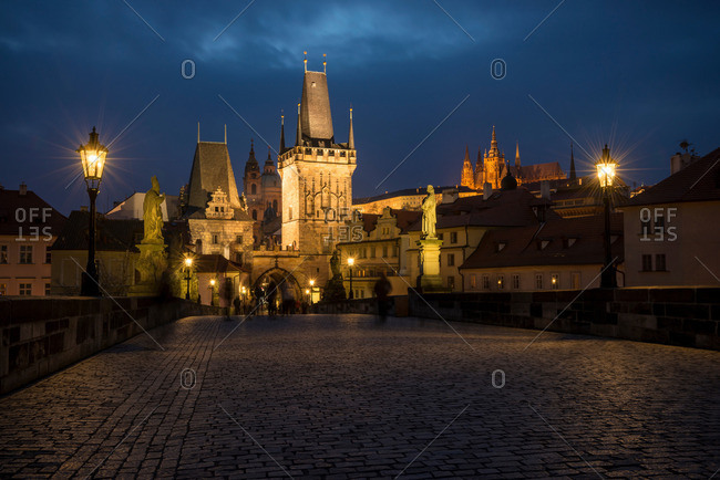 Charles Bridge with Prague Castle in background at night, Prague, Czech Republic