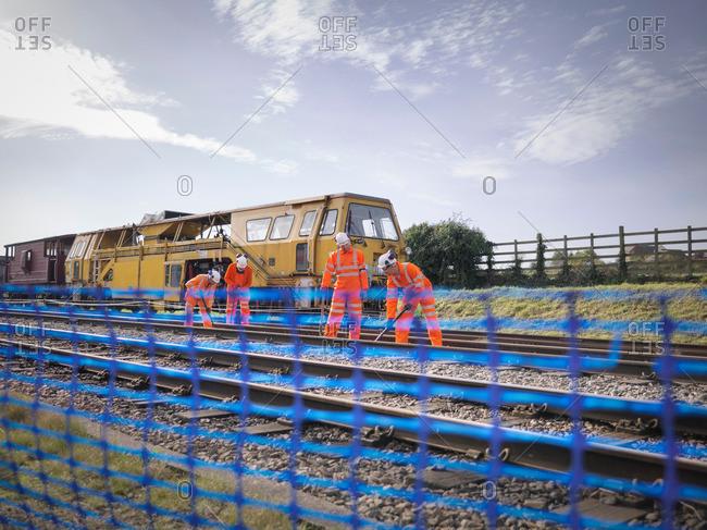 Railway maintenance workers on railway track