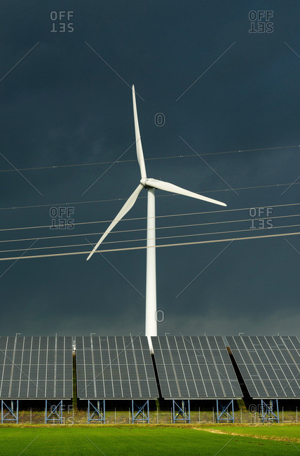 Wind turbine and solar panels on former waste dump, Waalwijk, Noord-brabant, Netherland