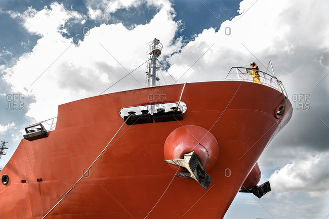 Low angle view of worker on board oil tanker