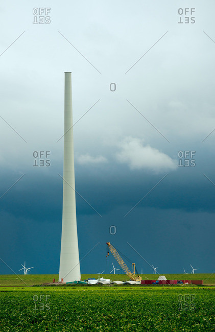 Thunderstorm approaching a wind turbine under construction, Netherlands
