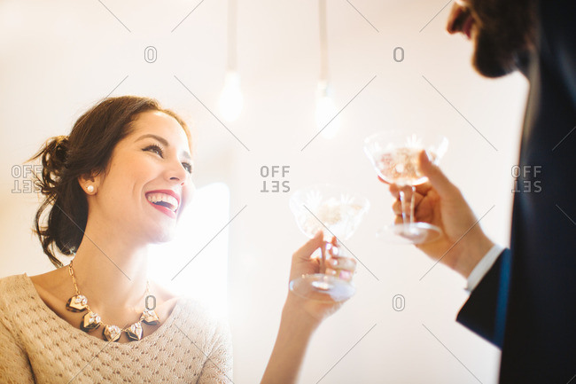 Stylish young couple raising a toast before night out