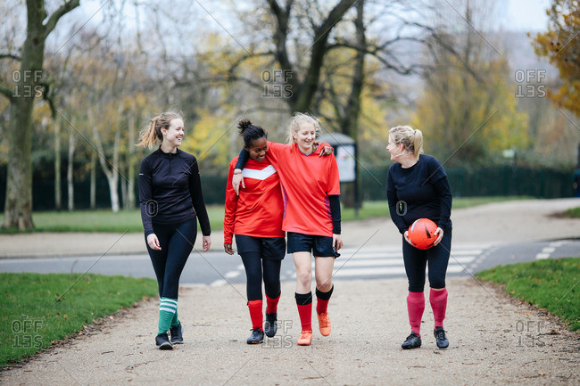 Female soccer players en route to play soccer in park