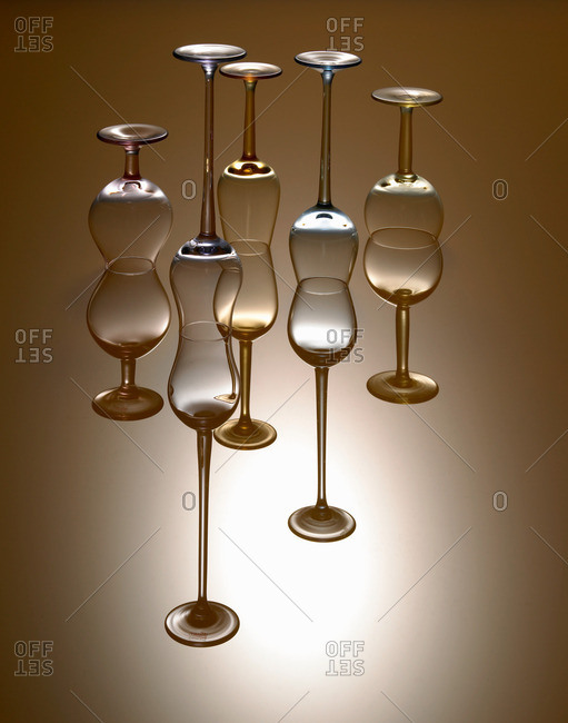 Upside down wine glasses, studio shot
