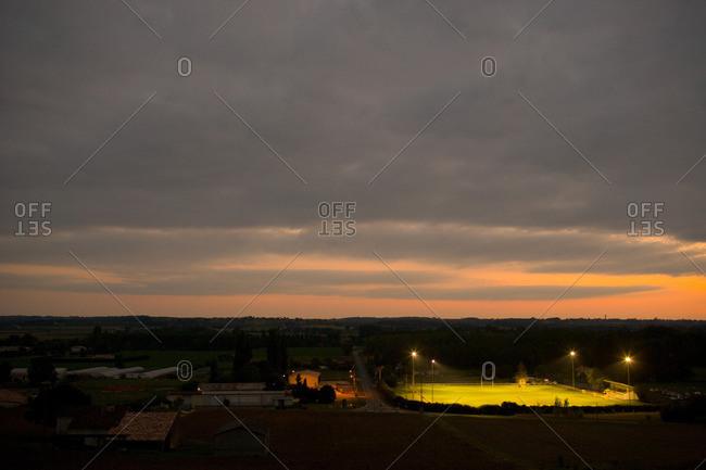 Illuminated playing field at dusk