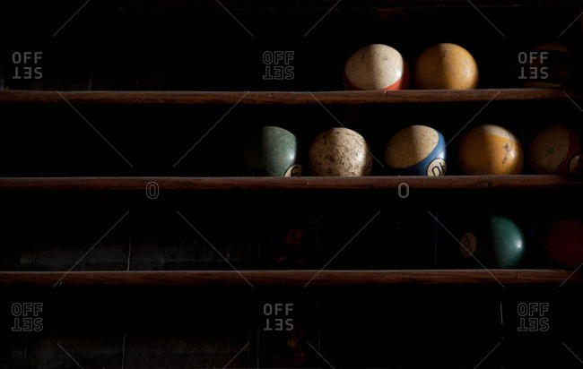 Pool balls on shelf