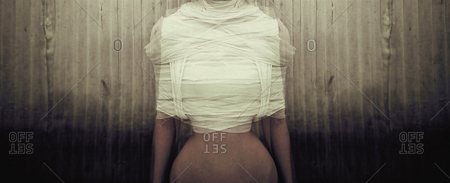 Female body wrapped in bandages