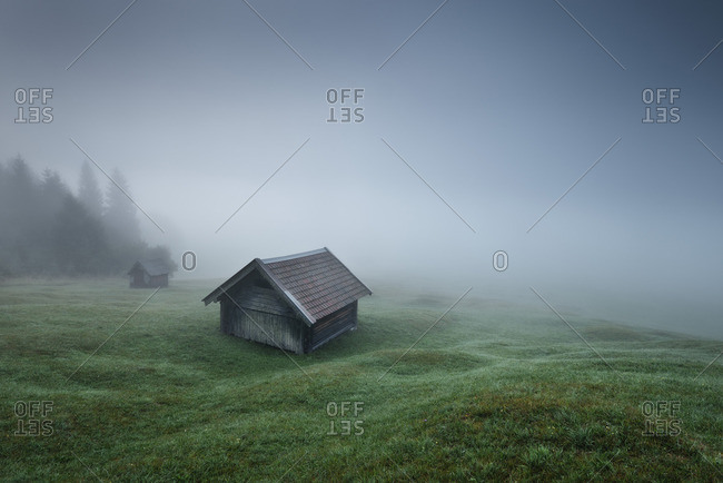 Shack on a foggy hill