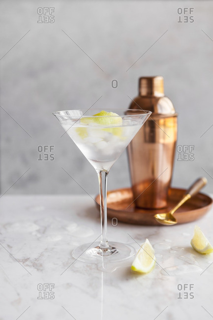 Martini served beside a copper cocktail shaker