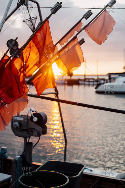 Flags of fishers in sundown