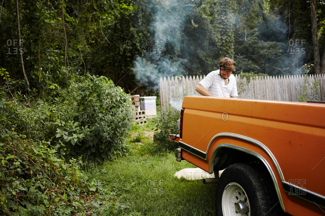 Man with smoke back of truck