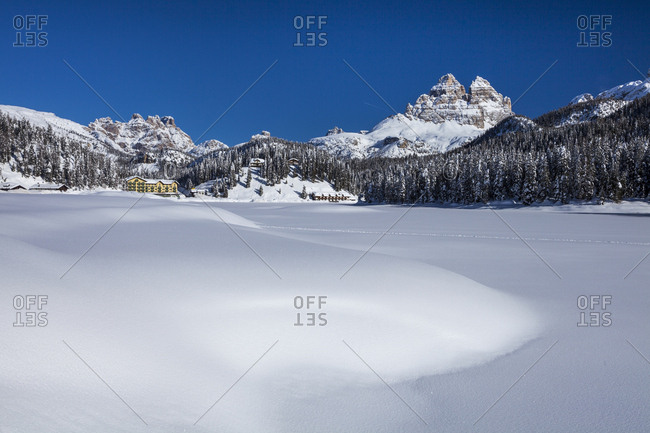 Misurina lake covered by snow with Tre