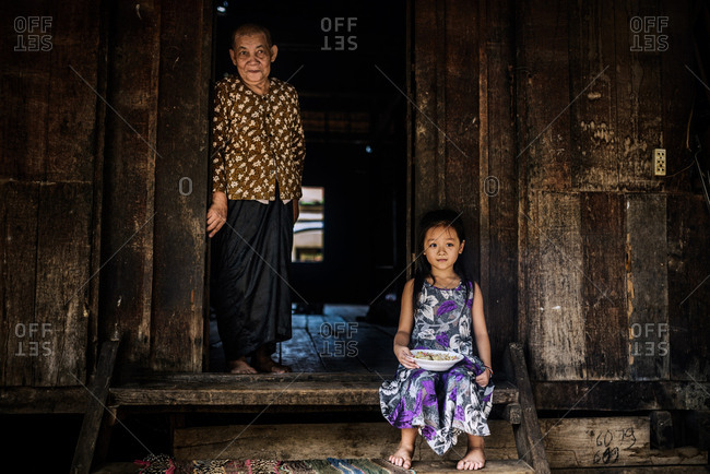 Siem Reap, Cambodia   - August 28, 2014: Grandmother and granddaughter