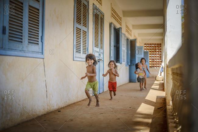 Siem Reap, Cambodia   - August 27, 2014: Happy children at Kompong Kleang