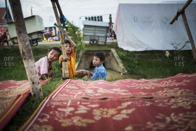 Siem Reap, Cambodia   - August 26, 2014: Three brothers by laid out blankets