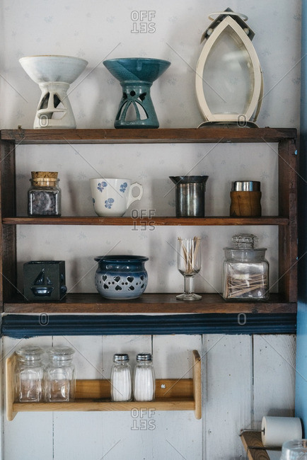 Shelves with displaying kitchen objects