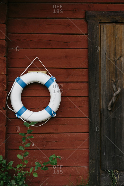 Door to houseboat with life preserver, Finland