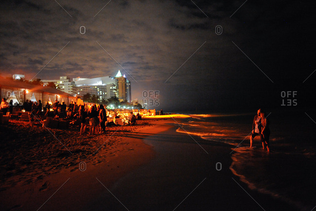 A crowd at beach party