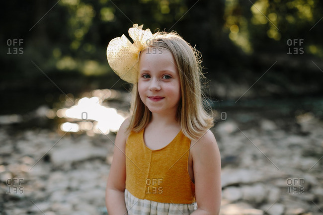 Portrait of a little girl with yellow bow in her hair
