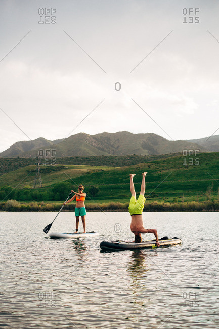 Colorado, USA - May 23, 2016: Paddle boarders at a reservoir in Colorado