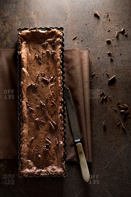 Chocolate dessert in a long fluted pan
