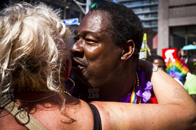 7/1/13: A participant greets a crowd member at the Gay Pride parade in Toronto, Canada.