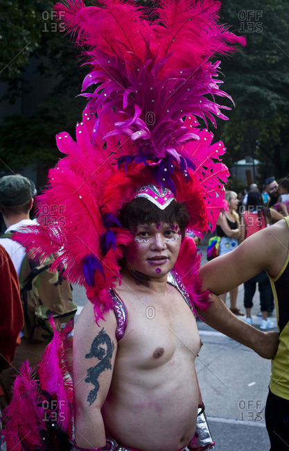 7/1/13: A man in a feathered headdress at the Gay Pride parade in Toronto, Canada.