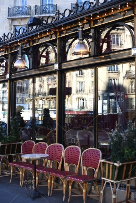 2/16/16: Tables and chairs in front of an outdoor cafe in Paris, France
