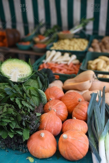 Produce outside in a farmers market stall