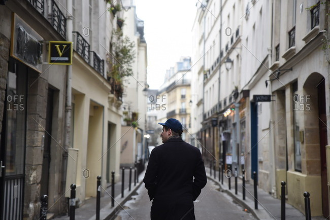 2/22/16: Man walking along a narrow street in Paris, France