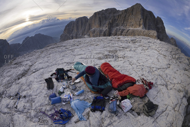 Mountaineer relaxing on a plateau near Madonna di Campiglio in the Eastern Alps, Italy