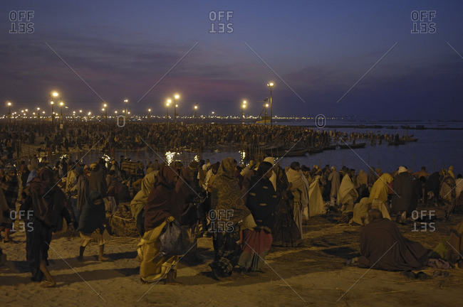 Uttar Pradesh, India - January 26, 2010: A Hindu crowd in celebration at dawn on the Yamuna river