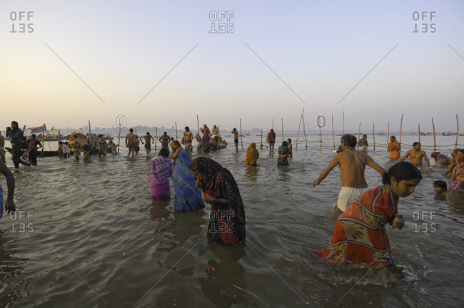 Uttar Pradesh, India - January 26, 2010: People bathing in the Yamuna river