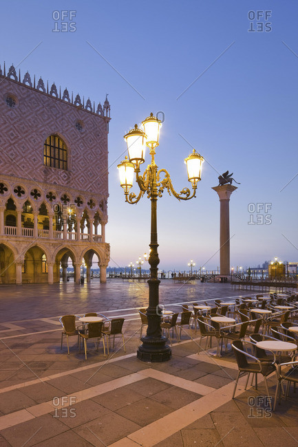 Night view of outdoor cafe at Doge's Palace, Piazza San Marco, Venice, Italy